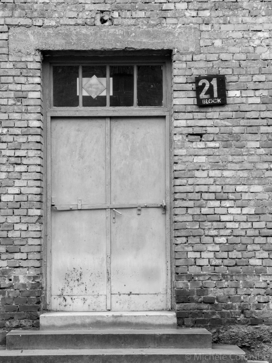 The door of the block 21 in Auschwitz. Black and white.