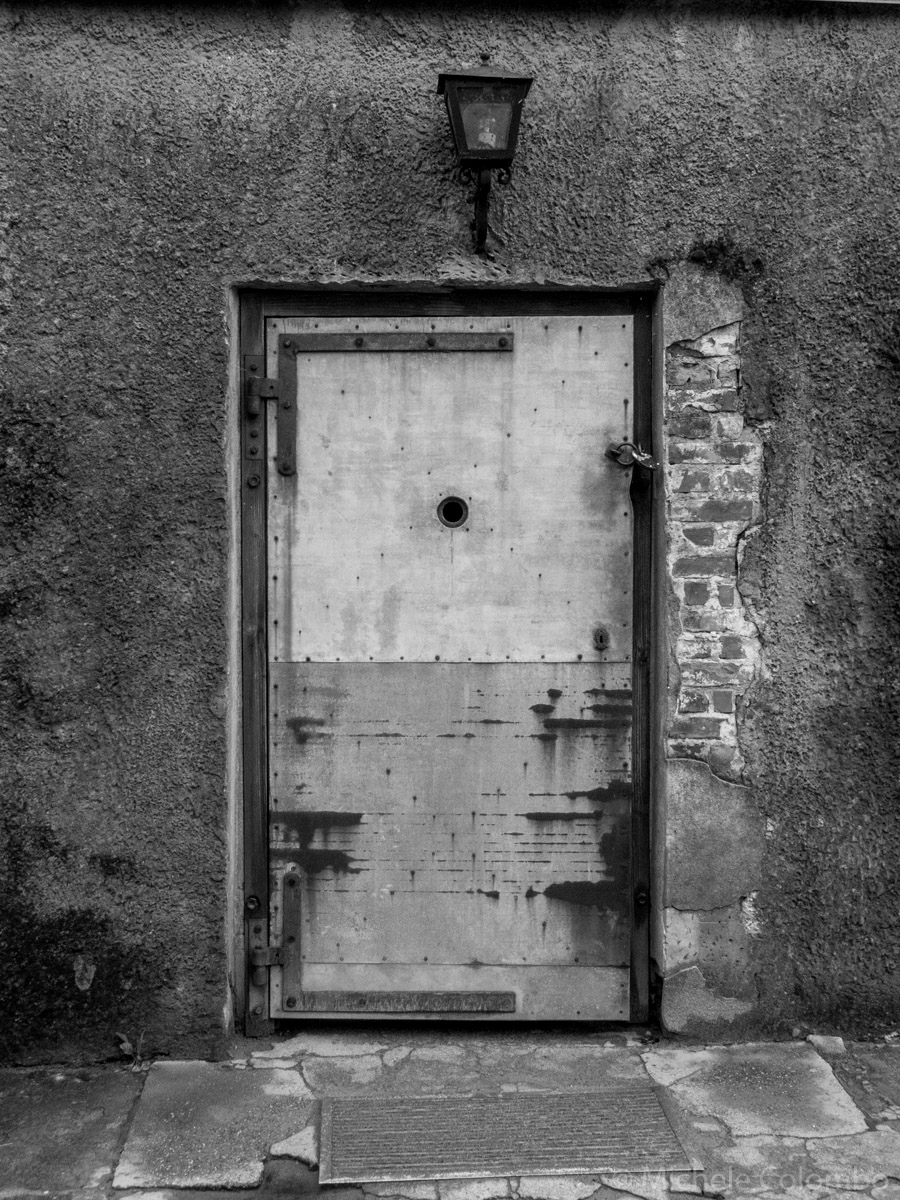 Door of a gas chamber in Auschitz. Black and white.