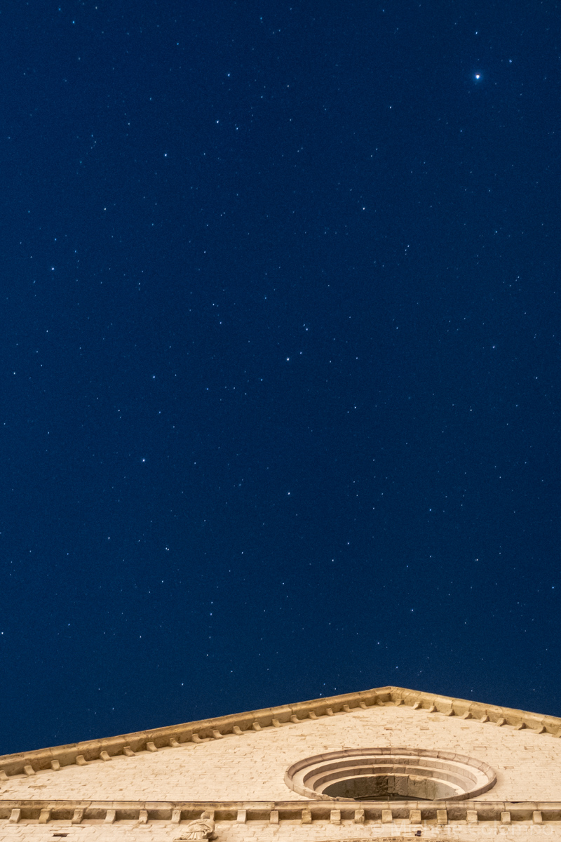 Stars in blue sky over a church