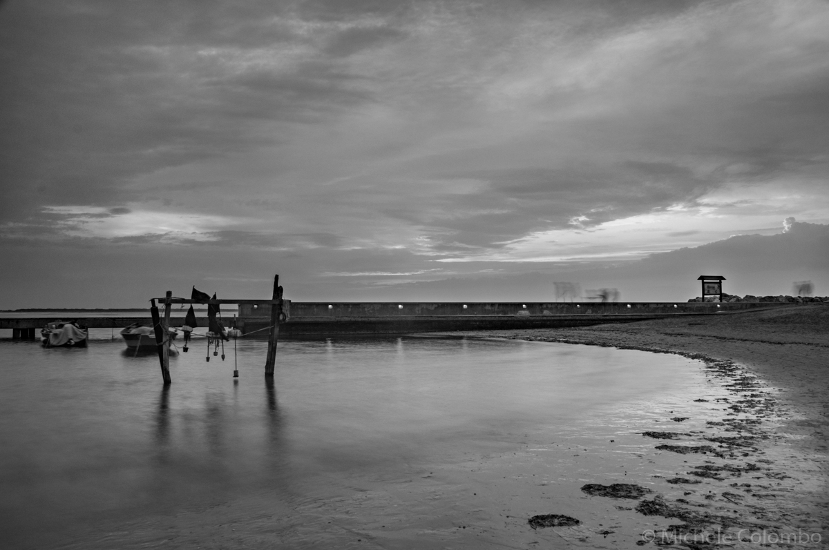 Black and white shot of pier in Caorle