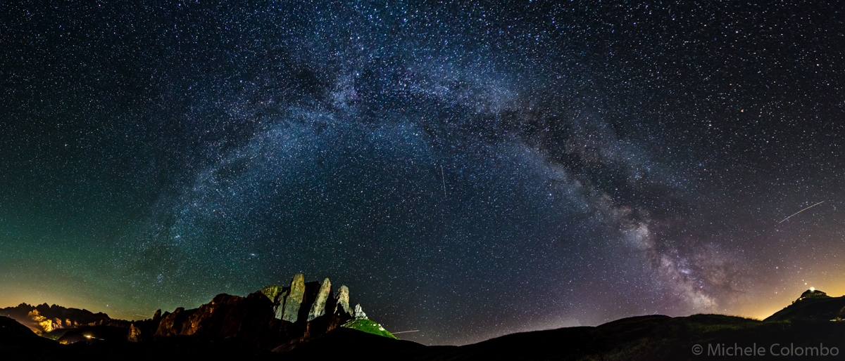 complete arch of Milky way above mountains