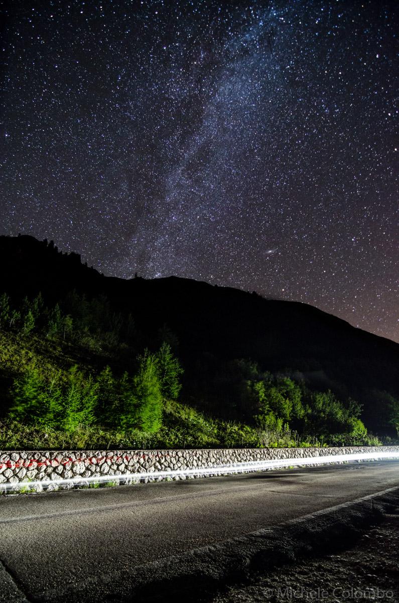 Light trails under starry sky