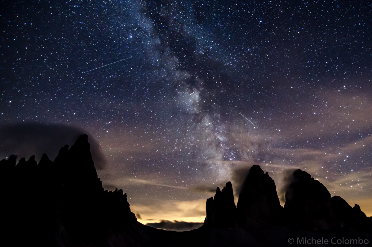 Photo of the milky way over Dolomites silhouette