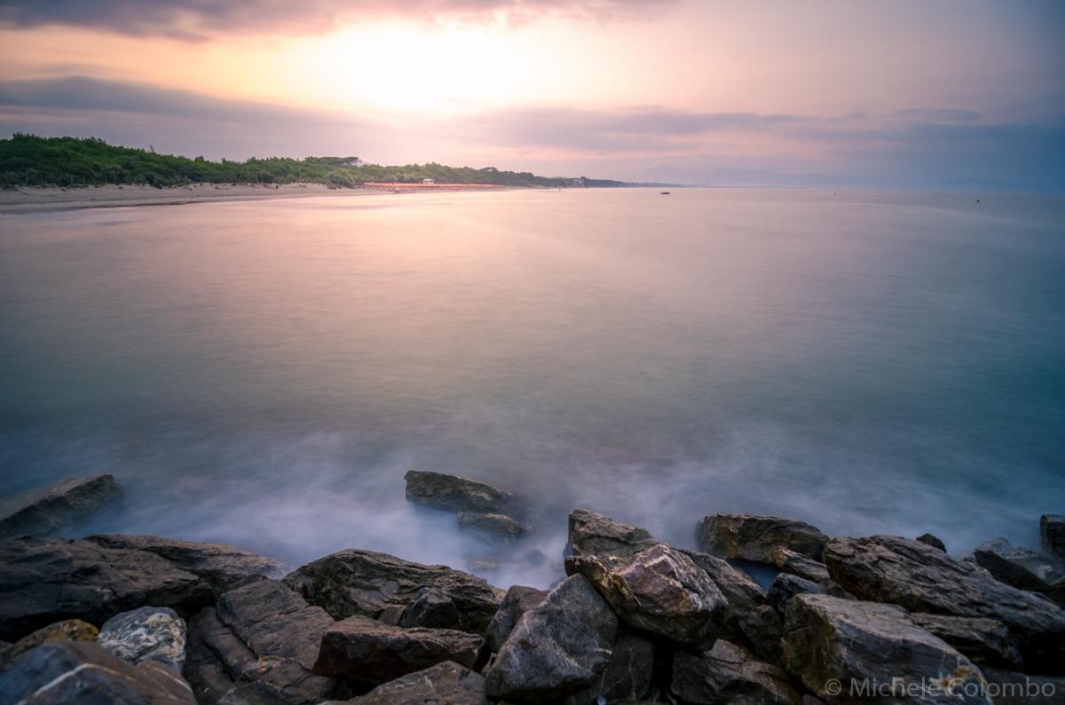 Waves against rocks at dawn - long exposure