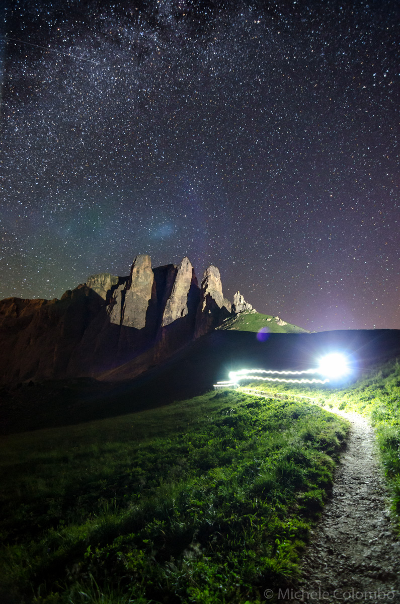 Light trail of climber und the starry sky