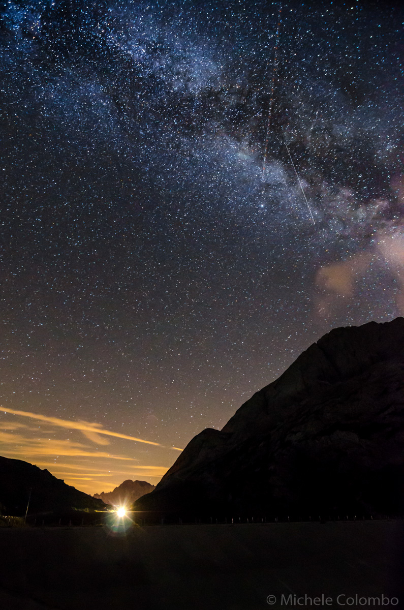 Milky way with lamp in the distance