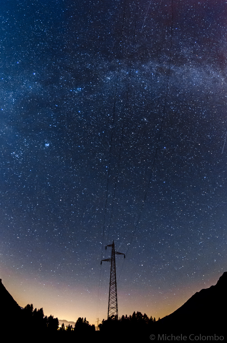 high tension pylon under milky way