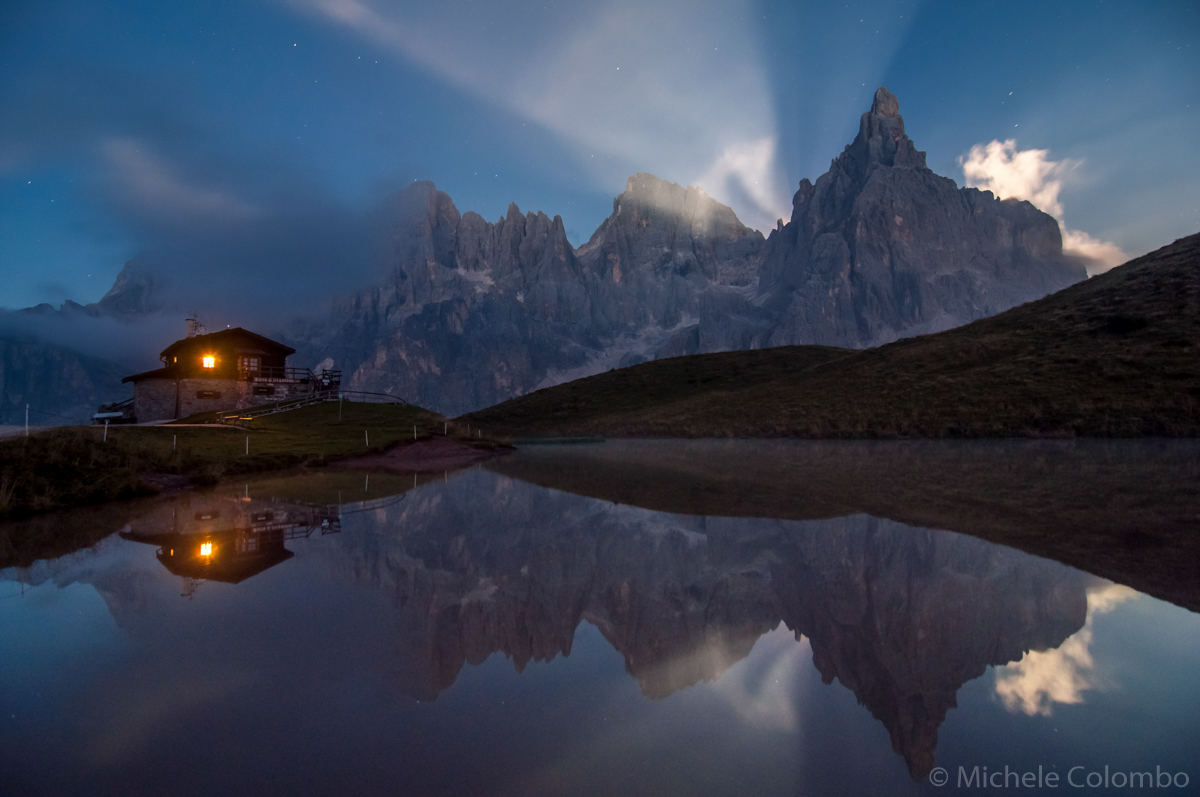 Pale di San Martino and baita segantini with moon beams