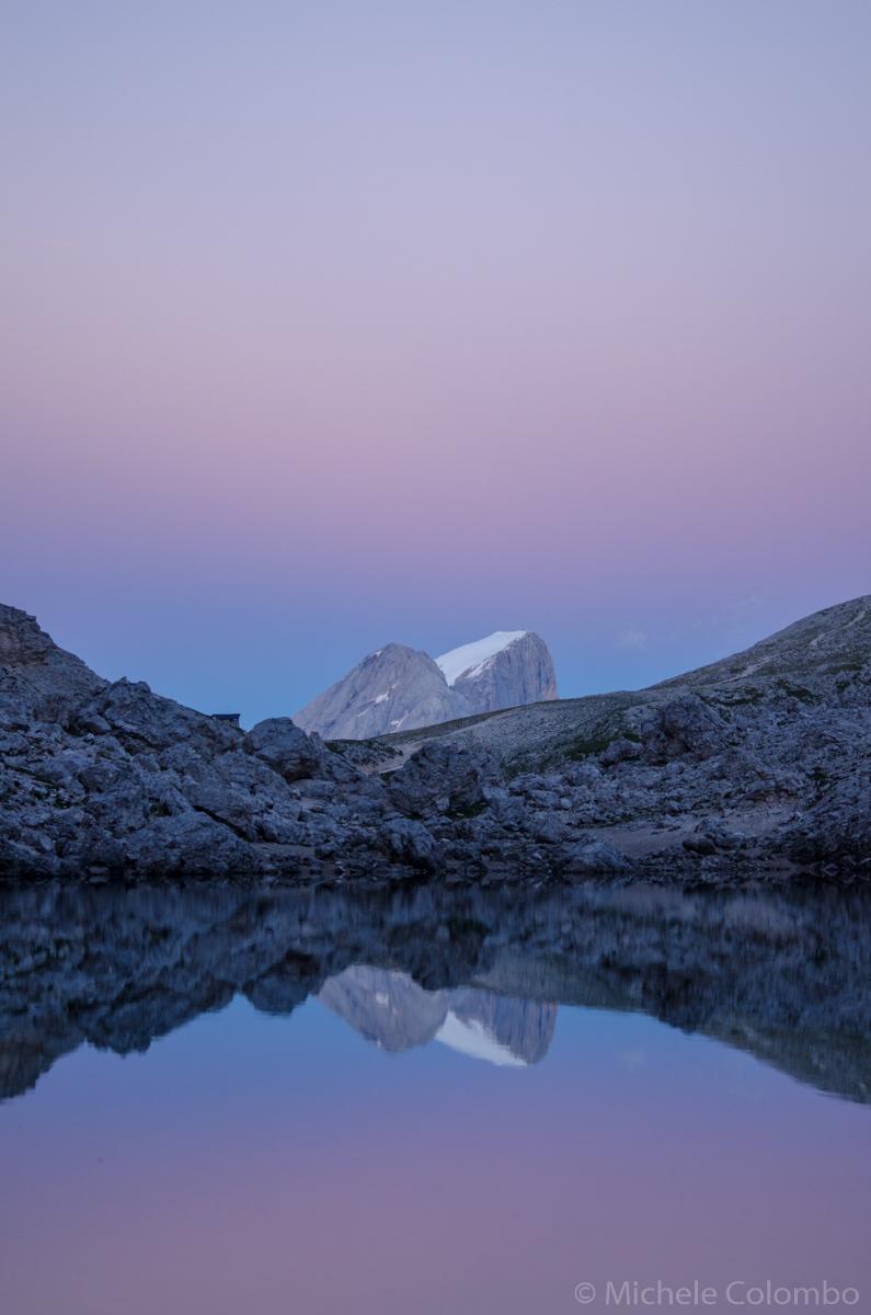 Marmolada reflected lake Antermoia at sunset