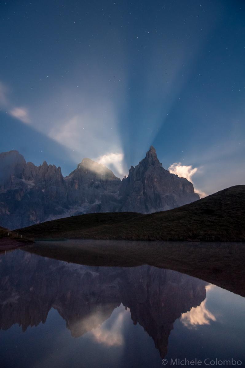 lake Segantini reflecting Dolomites with moon beams