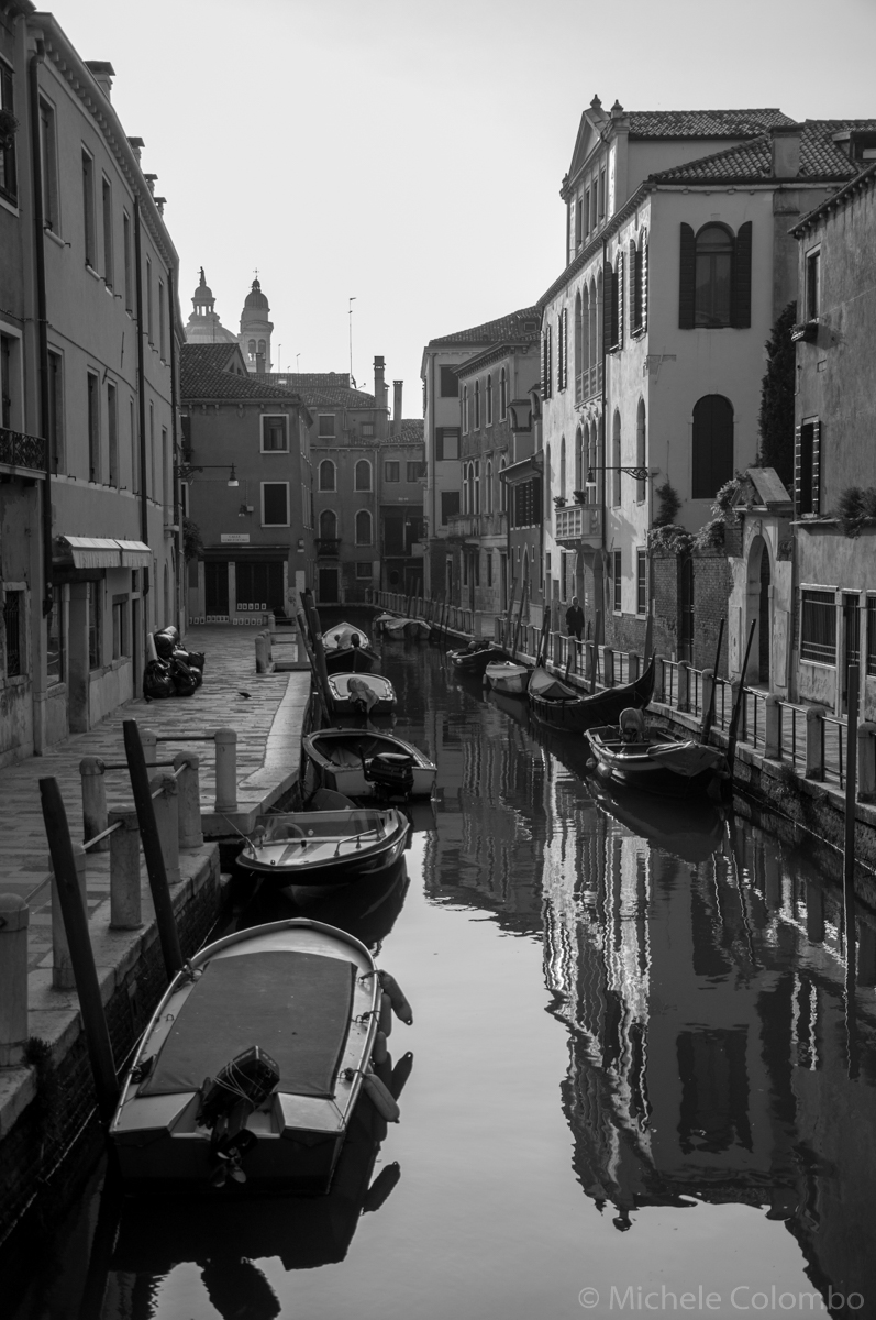 boats in a Venice canal in the morning