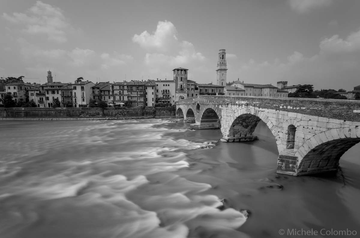 Black and white shot of Adige river in Verona.