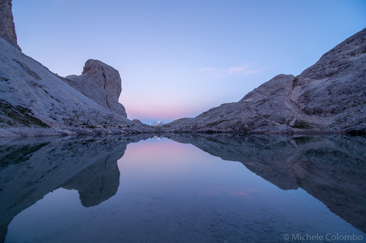 Reflection in alpine lake at dusk