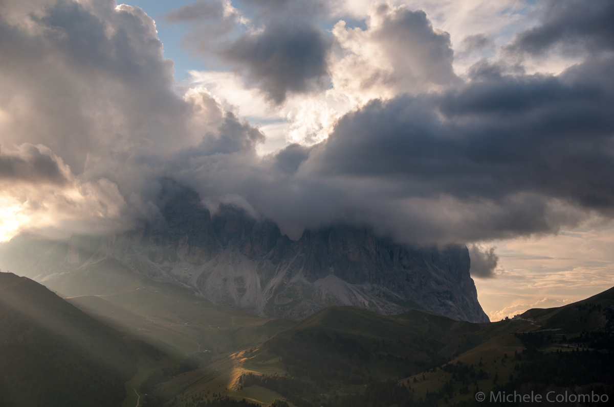 dolomites with sun beams at sunset